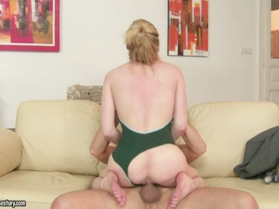Bald fucker gets a footjob from seductive beauty Lily LaBeau